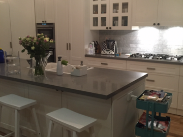 Renting out with online payment: Lovely hamptons style kitchen with leafy outlook