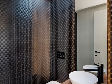 Renting out with online payment: Architectural Powder room with Black Tiling