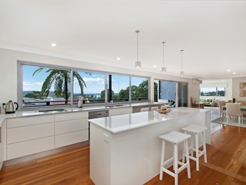 Renting out with online payment: Modern kitchen / dining area with garden and ocean outlook.