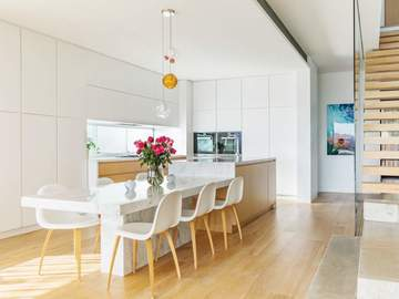 Renting out with online payment: Dining Area Built Right Into the Stone Countertops