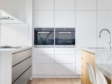 Renting out with online payment: Modern Kitchen with Stone Countertop