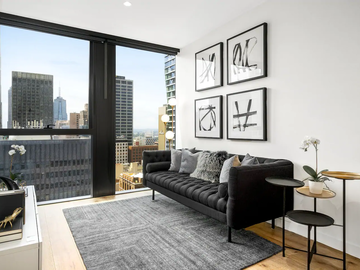 Renting out with online payment: Living Area with Stunning Black Sofa