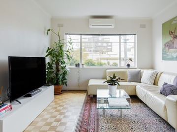 Renting out with online payment: Bright Living Area with Indoor Plants in the Corner