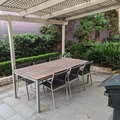 Renting out with online payment: Outdoor table and also seating/garden along side of house