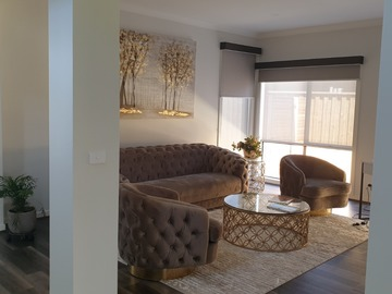 Renting out with online payment: Living room cordinated in gold and brown hues