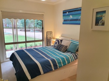 Renting out with online payment: Bedroom with a Blue Themed Bed and Artwork