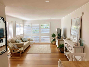 Renting out with online payment: Living Room with Ample Light and Plantation Shutters