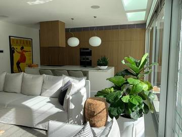 Renting out with online payment:  White Open Plan Kitchen with Timber Features