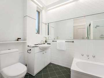 Renting out with online payment: Spacious White Bathroom with Black Feature Tiles