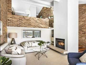 Renting out with online payment: Light-Filled Living Room with Open Wood Fireplace