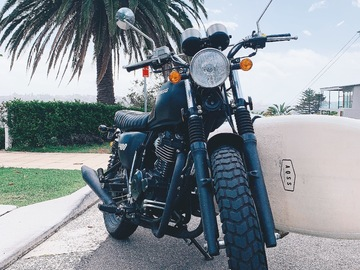 Renting out with online payment: Cool scrambler motorbike with surf racks